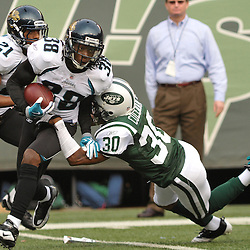 Nov 15, 2009; East Rutherford, NJ, USA; New York Jets cornerback Drew Coleman (30) tackles Jacksonville Jaguars cornerback Brian Witherspoon (38) on a punt return during first half NFL action between the New York Jets and Jacksonville Jaguars at Giants Stadium.