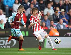 Moritz Bauer of Stoke City (R) in action - Mandatory by-line: Jack Phillips/JMP - 22/04/2018 - FOOTBALL - Bet365 Stadium - Stoke-on-Trent, England - Stoke City v Burnley - English Premier League