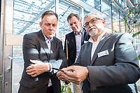 26 AUG 2015, EINBECK/GERMANY:<br /> Thomas Oppermann, SPD Fraktionsvorsitzender, Hagen Duenborstel, Vorstandssprecher KWS-Saat SE, und Juergen Schweden, Research & Development KWS Saat, (v.L.n.R.), waehrend einem Besuch der KWS-Saat SE im Rahmen von Oppermanns Sommerreise<br /> IMAGE: 20150826-01-079