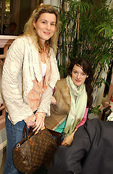 Left to right, ALEX GORE BROWNE and POPPY FRASER at a fashion show of Sybil Stanislaus Summer 2005 collection with jewellery by Philippa Holland held at The Lanesborough Hotel, Hyde Park Corner, London on 13th April 2005.<br /><br />NON EXCLUSIVE - WORLD RIGHTS