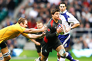 Ben Youngs of England escapes Rocky Elsom's tackle during the Investec series international between England and Australia at Twickenham, London, on Saturday 13th November 2010. (Photo by Andrew Tobin/SLIK images)