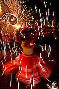 MEXICO, OAXACA, FESTIVALS Christmas, women with fireworks