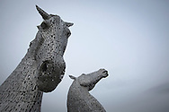 NOT FOR PUBLICATION WITHOUT PRIOR AGREEMENT OF FEES. NO ARCHIVING OR SYNDICATION PERMITTED.<br /> <br /> The Kelpies, made by Scottish sculptor Andy Scott, at his workshop in Maryhill, Glasgow, where he is currently constructing a memorial statue to men who lost their lives in the Scottish steel industry. Scott was best known for his twin horse sculptures entitled the Kelpies, which are located on the Forth and Clyde canal at Falkirk in central Scotland. The memorial to the steel men had a proposed completion date of spring 2015 and will be sited at Ravenscraig in Lanarkshire, on the site of Europe's largest former hot strip mill, which closed in 1992.