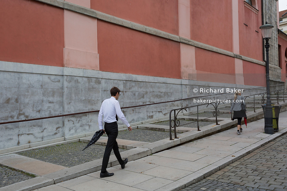 A man walks up Miklosiceva Cesta (street) in the Slovenian capital, Ljubljana, on 28th June 2018, in Ljubljana, Slovenia.