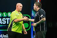 Michael Smith congratulates Michael van Gerwen on his victory in the quarter final during the Unibet Masters at stadium:mk, Milton Keynes, England on 31 January 2016. Photo by Shane Healey.