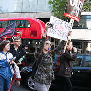 An unscheduled demonstration against the newly elected Conservative govenment makes it's way through Central London past Downing Street several times. After 5 years of coalition rule with severe austerity policies the Conservative party led by David Cameron won the general election and the demonstrators fear another 5 years of cuts. The Protest went on peacefully but loud closely followed by the police.