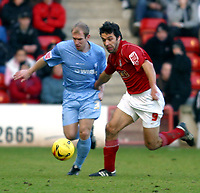 Photo: Dave Linney.<br />Walsall v Tranmere Rovers. Coca Cola League 1.<br />26/12/2005.Gareth Roberts(Tranmere) tangles with    Jorge Leitao(Walsall)