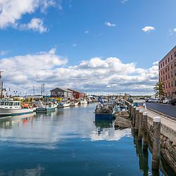 Fishing boats docked on Union Wharf in Portland, Maine.