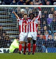 Photo: Richard Lane.<br /> Wimbledon v Stoke City. FA Cup 5th Round. 03/01/2004.<br /> John Eustace celebrates with Adi Akinbiyi