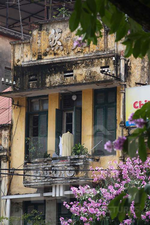 Facade of a weathered chinese style building, Hanoi, Vietnam, Southeast Asia