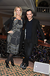 EMMA WOOLLARD and KINDER AGGUGINI at the unveiling of the Claridge's Christmas tree 2011 designed by Alber Elbaz for Lanvin held at Claridge's, Brook Street, London on 5th December 2011.