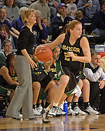 Baylor gurad Jordan Davis (22) drives as Lady Bears head coach Kim Mulkey-Robertson (L) calls out instructions during the second half against Kansas State at Bramlage Coliseum in Manhattan, Kansas, February 25, 2006. The 10 ranked Lady Bears defeated K-State 79-70.