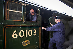 © Licensed to London News Pictures. 20/05/2021. London, UK. Two train drivers talk to each other as The LNER Flying Scotsman steam locomotive prepares to leave Victoria Station in central London ahead of a tour through the Surrey Hills in South east England. The heritage steam locomotive touring season was mostly cancelled last year due to the Covid-19 pandemic but is now underway as restrictions are eased. Built in 1923 for the London and North Eastern Railway (LNER)It was the first steam locomotive to reach 100 miles per hour . Photo credit: Ben Cawthra/LNP