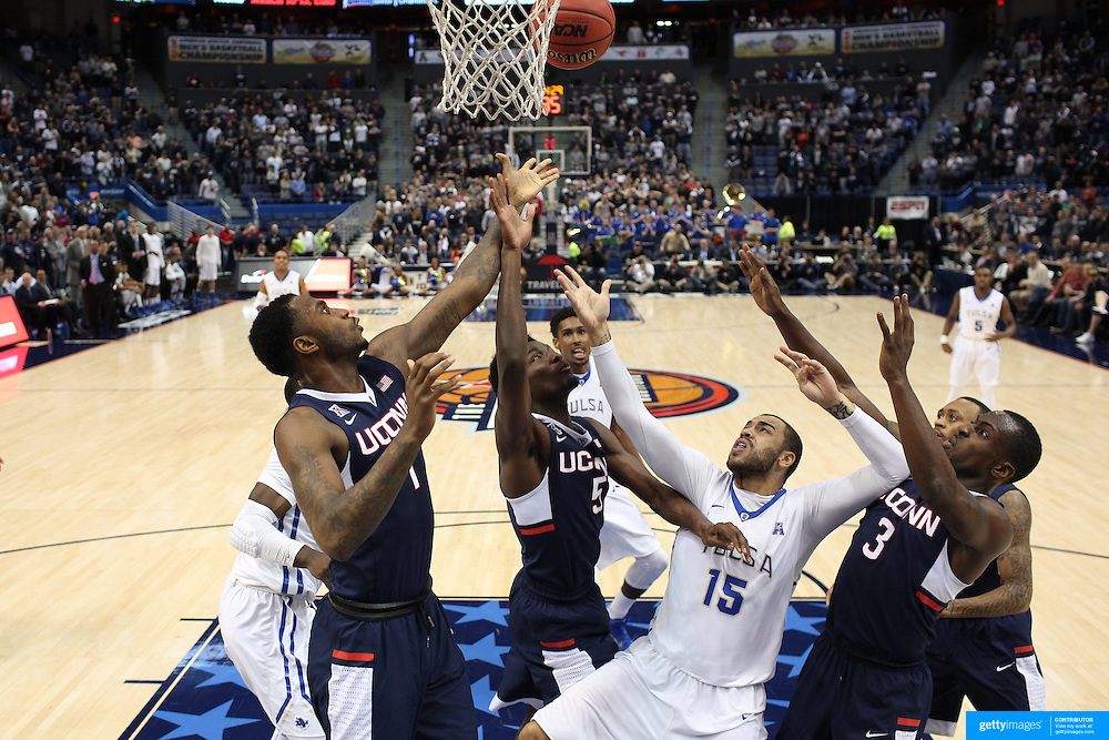 Marquel Curtis, (center), Tulsa, shoots while challenged by Phillip Nolan, (left), Daniel Hamilton and Terrence Samuel, (right), UConn, during the UConn Huskies Vs Tulsa Semi Final game at the American Athletic Conference Men's College Basketball Championships 2015 at the XL Center, Hartford, Connecticut, USA. 14th March 2015. Photo Tim Clayton