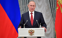 June 12, 2017 - Moscow, Russia - Russian President Vladimir Putin speaks during a ceremony presenting passports to ten Russian students in the Kremlin June 12, 2017 in Moscow, Russia. The ceremony was part of the We Are Citizens of Russia nationwide action. (Credit Image: © Sergey Guneev/Planet Pix via ZUMA Wire)