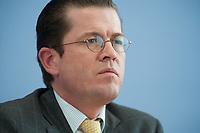 12 APR 2010, BERLIN/GERMANY:<br /> Karl-Theodor zu Guttenberg, CDU, Bundesverteidigungsminister, waehrend einer Pressekonferenz zur Vorstellung der Strukturkommission der Bundeswehr, Bundespressekonferenz<br /> IMAGE: 20100412-01-017