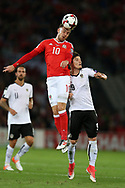 Aaron Ramsey of Wales jumps for a header with Marcel Sabitzer of Austria. Wales v Austria , FIFA World Cup qualifier , European group D match at the Cardiff city Stadium in Cardiff , South Wales on Saturday 2nd September 2017. pic by Andrew Orchard, Andrew Orchard sports photography