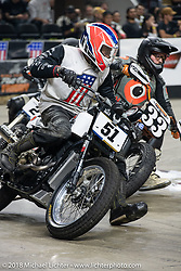 Hooligans race into turn one at the Flat Out Friday flat track racing on the Dr. Pepper-covered track in the UW-Milwaukee Panther Arena during the Harley-Davidson 115th Anniversary Celebration event. Milwaukee, WI. USA. Friday August 31, 2018. Photography ©2018 Michael Lichter.