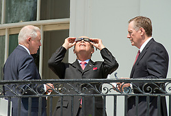 United States Secretary of Commerce Wilbur Ross, center, looks at the partial eclipse of the sun from the Blue Room Balcony of the White House in Washington, DC on Monday, August 21, 2017.  Looking on from left is US Attorney General Jeff Sessions and from right is US Trade Representative Robert E. Lighthizer.<br /> Credit: Ron Sachs / CNP