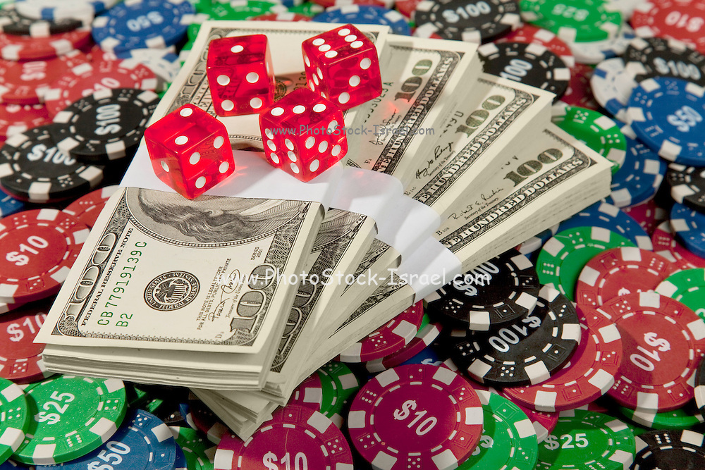 Money, Dice and Poker Chips on a green felt poke table