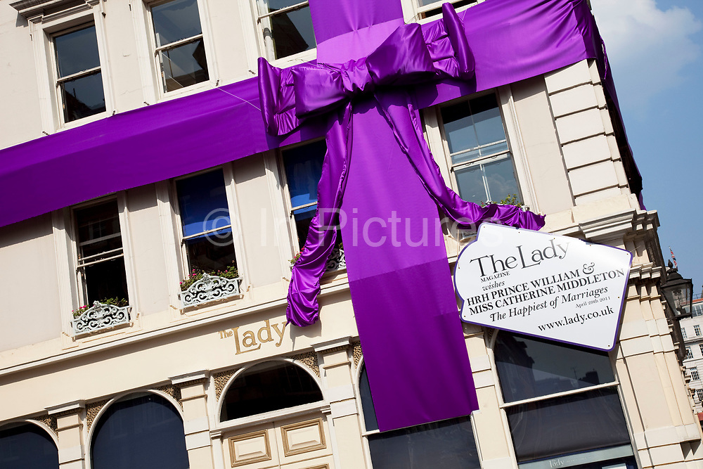 In a very pro-royal statement a giant ribbon bow adorns the offices of 'The Lady' magazine to celebrate the Royal Wedding of Prince William and Kate Middleton, making the building look like a huge parcel. In continuous publication since 1885 and widely respected as England's longest running weekly magazine for women, The Lady is celebrated both for the quality of its editorial pages and its classified advertisements.