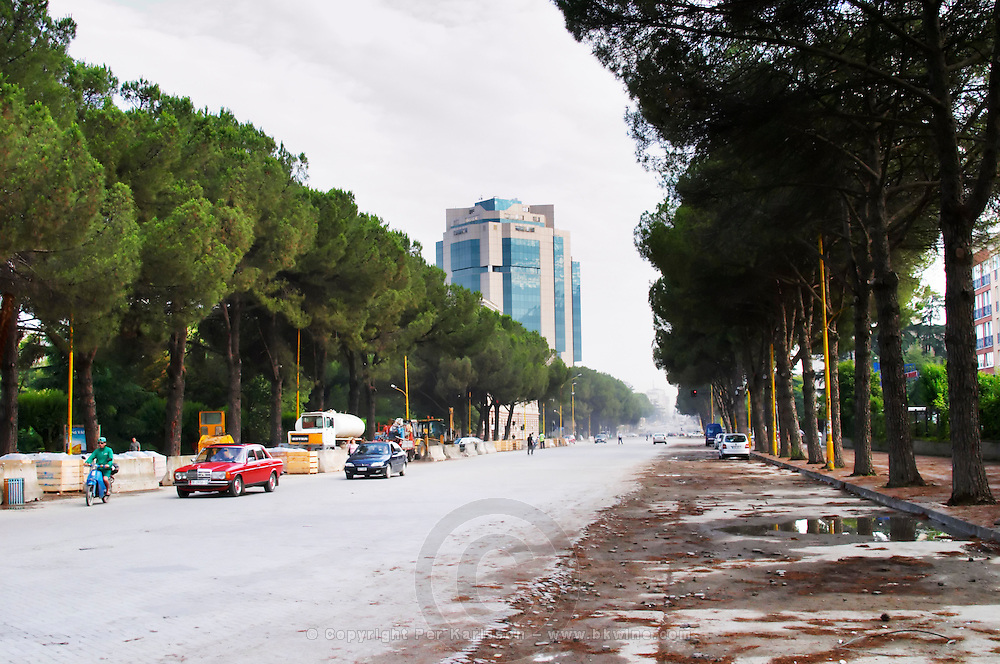 View along the boulevard Bulevardi Deshmoret e Kombit. The modern Sky tower office complex. Tirana capital. Albania, Balkan, Europe.