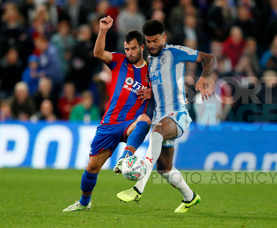 Crystal Palace's Luka Milivojevic tussles with Huddersfield's Phil Billing during the Carabao cup match at Selhurst Park Stadium, London. Picture date 19th September 2017. Picture credit should read: David Klein/Sportimage