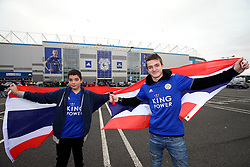 Leicester City fans Jordan Partridge (right) and Richard Brown pose with the flag of Thailand in honour of Vichai Srivaddhanaprabha outside the stadium before the match against Cardiff City at Cardiff City Stadium