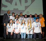 """16/02/2014 Shinjuku , St. Paul's Oughterard Galway(pictured with Paul Sleem MC and Yvonne McArdle SAP) at the 8th annual SAP FIRST LEGO League challenge in Galway! The global theme for this year's competition; """"Nature's Fury"""" was very apt for Irish Students and many of the projects were inspired by recent disastrous impact of the weather in local communities.<br /> <br /> The winners, SGC Robotics from St. Gerald's Secondary School in Castlebar, will now go on to represent Ireland at the European finals of the competition in Spain in May. They will follow in the footsteps of other very successful Irish teams who have in the past been recognised and awarded prizes on the international stage.<br /> Bernard Kirk, Director, The Galway Education Centre who brought the FIRST LEGO League to Ireland 8 years ago and have hosted it every year since, """" We see these students not just as LEGO and robotics experts, they are architects, engineers and genuine enthusiasts. Irish students have become recognised all over the world through their successes in this competition at global level and we are extremely proud of them and their teachers"""". Photo:Andrew Downes"""