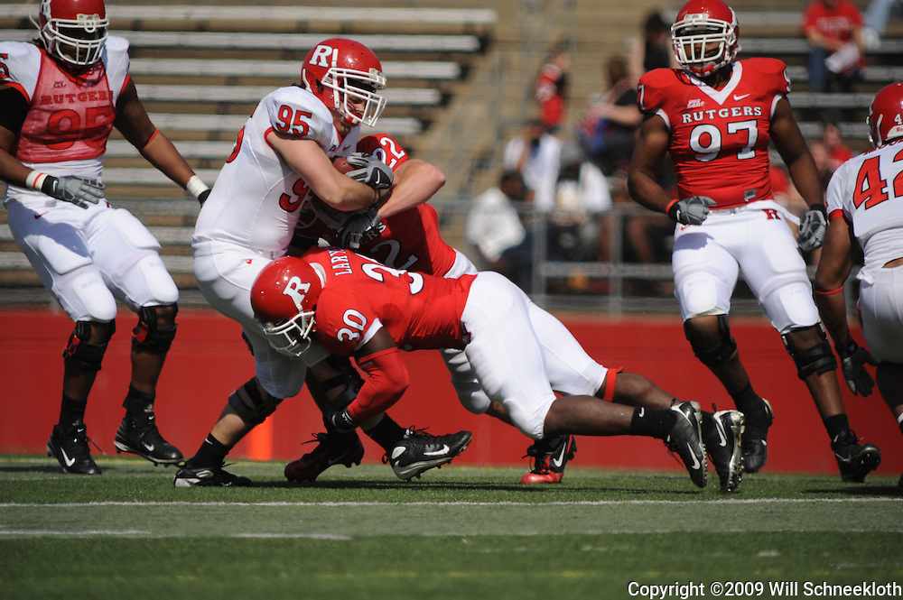 Apr 18, 2009; Piscataway, NJ, USA; Rutgers DL Remo Fioranelli (95) is tackled by LB Edmond Laryea (30) and DB Colin McEvoy (22) during the second half of Rutgers' Scarlet and White spring football scrimmage.