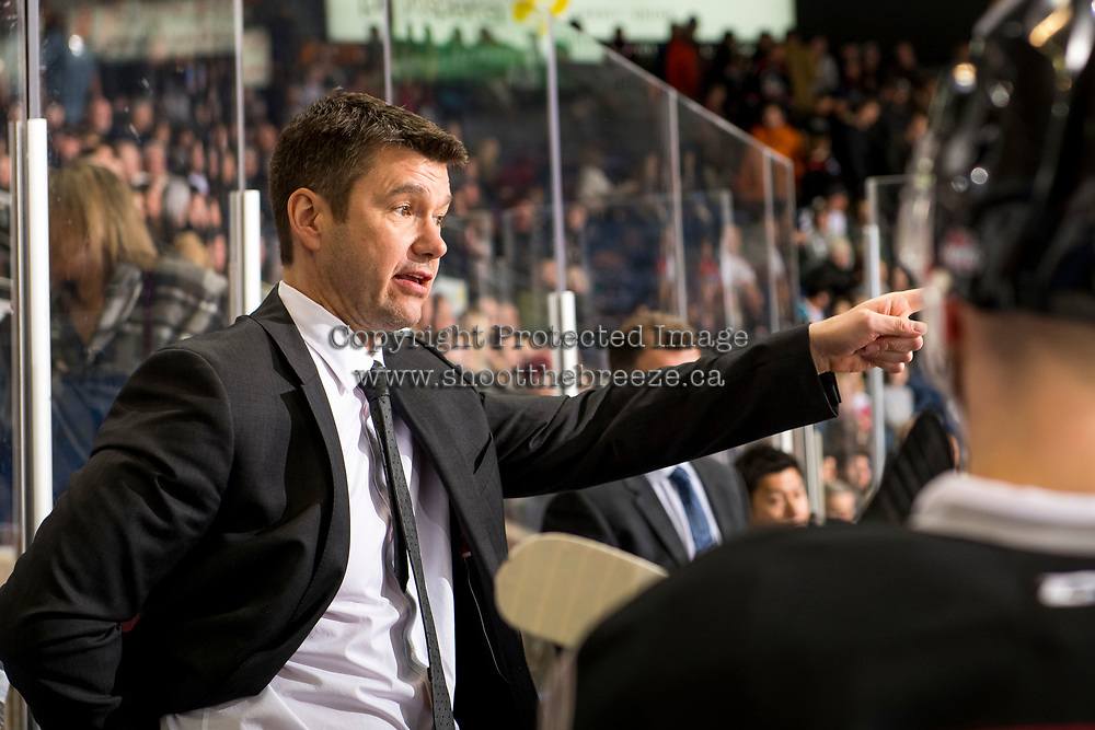 KELOWNA, BC - JANUARY 26:  Michael Dyck, head coach of the Vancouver Giants, stands on the bench speaking to players against the Kelowna Rockets at Prospera Place on January 26, 2019 in Kelowna, Canada. (Photo by Marissa Baecker/Getty Images)