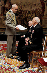 Colonel De Loustal from the French Parachute Regiment talks to veterans prior to them receiving the Legion d'honneur, France's highest distinction, from the French Ambassador Sylvie Bermann for their role in liberating France during the Second World War, during a ceremony at the Ambassador's residence in Kensington, London.