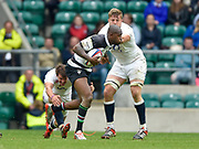 Barbarians wing Ugo Monye (Harlequins & England) tries to evade the tackles of England scrum-half Lee Dickson (Northampton Saints, captain) and lock Joe Launchbury (Wasps) during the International Rugby Union match England XV -V- Barbarians at Twickenham Stadium, London, Greater London, England on May  31  2015. (Steve Flynn/Image of Sport)