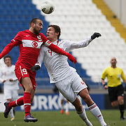 Turkey U21's Sercan Yildirim (L) and Denmark U21's Jannik Vestergaard (R) during their friendly soccer match Turkey U21 betwen Denmark U21 at Recep Tayyip Erdogan stadium in Istanbul February 29, 2012. Photo by TURKPIX
