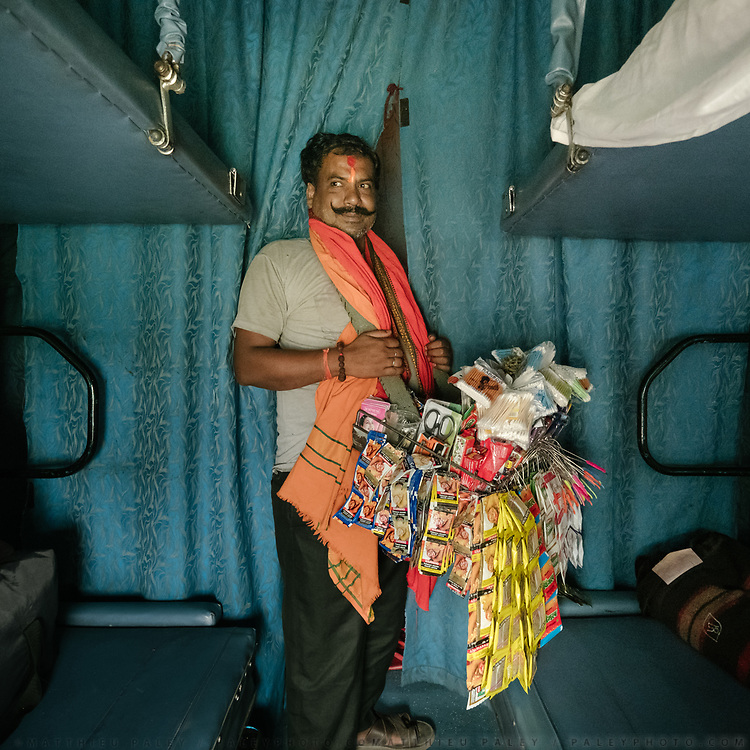 Peddler selling Chewing tabacco, q-tips, scissors etc. Throughout the journey, peddlers pop into the train compartments with all sorts of offerings,  to be bargained for a few rupees.<br /> Inside the Dibrugarh-Kanyakumari Vivek Express, the longest train route in the Indian Subcontinent. It joins Kanyakumari, Tamil Nadu, which is the southernmost tip of mainland India to Dibrugarh in Assam province, near the border with Burma.