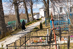 Graveyard at the Russian Orthodox church in the Saint Nicolay nunnery monastery in Sanino, near the Golden Ring town of Suzdal, Russia. Tuesday April 25, 2017. Photography ©2017 Michael Lichter.