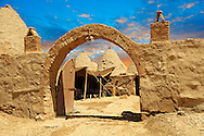 """Pictures of the beehive adobe buildings of Harran, south west Anatolia, Turkey.  Harran was a major ancient city in Upper Mesopotamia whose site is near the modern village of Altınbaşak, Turkey, 24 miles (44 kilometers) southeast of Şanlıurfa. The location is in a district of Şanlıurfa Province that is also named """"Harran"""". Harran is famous for its traditional 'beehive' adobe houses, constructed entirely without wood. The design of these makes them cool inside. 41 .<br /> <br /> If you prefer to buy from our ALAMY PHOTO LIBRARY  Collection visit : https://www.alamy.com/portfolio/paul-williams-funkystock/harran.html<br /> <br /> Visit our TURKEY PHOTO COLLECTIONS for more photos to download or buy as wall art prints https://funkystock.photoshelter.com/gallery-collection/3f-Pictures-of-Turkey-Turkey-Photos-Images-Fotos/C0000U.hJWkZxAbg ."""