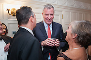 New York City Mayor Bill DiBlasio greets guests at the Brooklyn Kindergarten Society's 2016 Yuletide Ball.