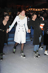 LILY COLE (White coat) at a Winter Party given by Tiffany & Co. Europe to launch the 10th season of Somerset House's Ice Skating Rink at Somerset House, The  Strand, London on 16th November 2009.