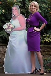 © licensed to London News Pictures. London, UK 13/11/2012. Claire Alsop, 31, from Rotherham in South Yorkshire, posing with a cut-out from her wedding to show her new shape as she slimmed down from 21st 9lb to a 10st 1½lb. Now she's been named Slimming World's Woman of the Year 2012. Photo credit: Tolga Akmen/LNP