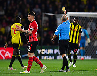 FOOTBALL - 2018 / 2019 Premier League - Watford vs Southampton<br /> <br /> Watford's Abdoulaye Doucoure is shown a yellow card by Referee Mike Dean, at Vicarage Road.<br /> <br /> COLORSPORT/ASHLEY WESTERN