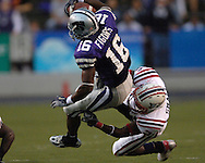Florida Atlantic defensive back Corey Small (26) tackles Kansas State wide receiver Yamon Figurs (16) after picking up a first down in the first half, at Bill Snyder Family Stadium in Manhattan, Kansas, September 9, 2006.  The Wildcats beat the Owls 45-0.