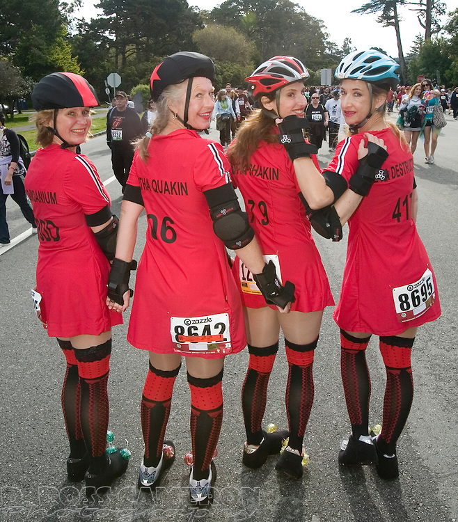 A group of women dressed as members of the San Francisco Quakes roller derby team pose for a photograph during the 100th running of the Bay to Breakers 12K, Sunday, May 15, 2011 in San Francisco. They are, from left, Pam Lindgren of Edgartown, Mass., Darce Vedrich of Milford, Conn., M.J. Rogers of Edgartown and Stacie Hill of Pittsburgh, Pa. (Photo by D. Ross Cameron)