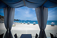 Deckchairs lined up on a luxury beach, Nha Trang, Vietnam, Southeast Asia
