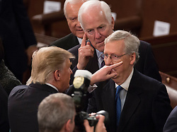 United States President Donald J. Trump chats with US Senators Orrin Hatch (R-UT) (rear), John Cornyn (R-TX)(center) and Senate Majority Mitch McConnell (Republican of Kentucky) after addressing a joint session of Congress on Capitol Hill in Washington, DC, USA, February 28, 2017. Photo by Chris Kleponis/CNP/ABACAPRESS.COM