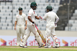 August 29, 2017 - Mirpur, Dhaka, Bangladesh - Bangladesh's Tamim Iqbal  and captain Mushfiqur Rahim punch gloves to each other during day three of the First Test match between Bangladesh and Australia at Shere Bangla National Stadium on August 29, 2017 in Mirpur, Bangladesh. (Credit Image: © Ahmed Salahuddin/NurPhoto via ZUMA Press)