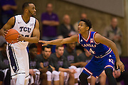 FORT WORTH, TX - JANUARY 28: Devonte Graham #4 of the Kansas Jayhawks defends against Trey Zeigler #32 of the TCU Horned Frogs on January 28, 2015 at Wilkerson-Greines AC in Fort Worth, Texas.  (Photo by Cooper Neill/Getty Images) *** Local Caption *** Devonte Graham; Trey Zeigler