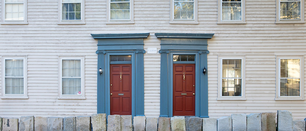 Wooden clapboard elegant period houses with stone barrier on Benefit Street in Providence, Rhode Island, USA