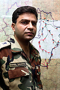 """Rahul Sharma head of the police in Dantewada district is seen standing in his command centre with a map showing inaccessible roads and areas in the district.  His assessment was that 40 per cent of the state was in naxal hands, 40 per cent was held by the government and they were fighting over the remaining 20.  """"It is the biggest casualty theatre for the Indian government in the country.  It is a full blown war and the naxals are migrating from guerillas to a full blown conventional army."""""""