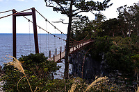 Kadowaki Suspension Bridge — The suspension bridge in Jogasaki is a famous tourist spot, at 23 meters in height and 48 meters in width. The Kadowaki Suspension bridge looms right above the Jogasaki coast, which was formed by the eruption of nearby Mt. Omuro, upon which the lava flow eroded in the sea, forming cliffs, bluffs and a craggy coastline.The bridge hangs over Cape Kadowaki, the scenery of the precipice eroded by seawater is both magnificent, beautiful but somewhat scary.
